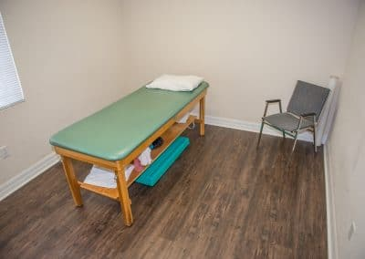 physical therapy private exam room with table