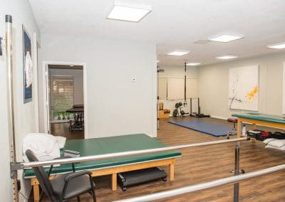 Physical Therapy in Bradenton therapy area with balance bars and treatment tables