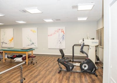 treatment table and cardio therapy area in physical therapy clinic