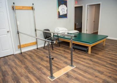 Physical Therapy in Bradenton Balance Bars and treatment table in gym area