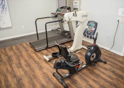 Physical Therapy clinic in Bradenton cardio area with treadmill, UBE and recumbent bike