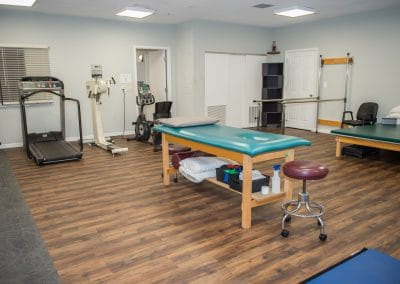 Physical Therapy clinic in Bradenton Gym Area with Cardio machines and treatment tables