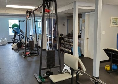 Weight room and exercise equipment at a Physical Therapy clinic located at 1705 Osprey Avenue Sarasota, Florida