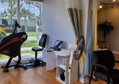 Physical Therapy clinic treatment area with UBE located at 1705 Osprey Avenue Sarasota Florida
