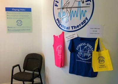 Physical Therapy waiting room Punta Gorda Florida reception chair, company logo on wall and company values poster