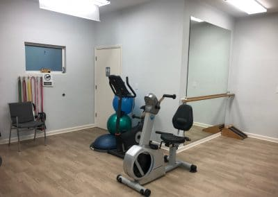 Physical Therapy clinic treatment area with UBE and exercise balls