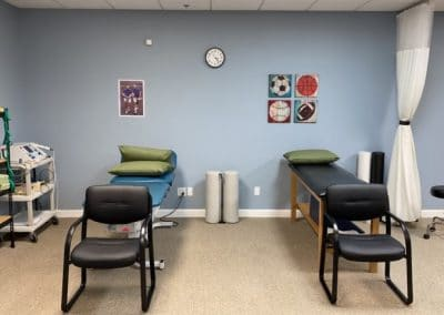 treatment tables in outpatient physical therapy clinic ultrasound machine