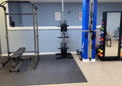 physical therapy clinic with weights therapy bands and hand weights